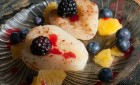 Baked Pear served with orange, berries and pomegranates.