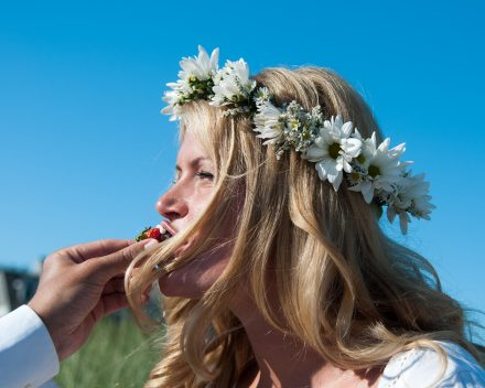 Bride being fed chocolare covered stawberries