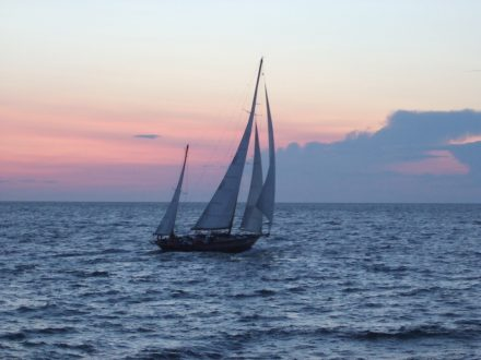 Sailboat with pink hues in the sky