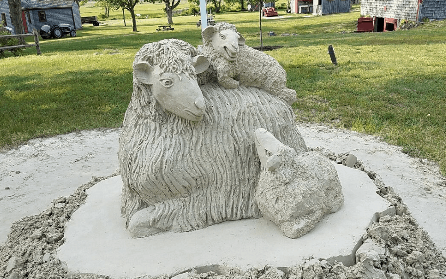 Sand art of a mother lamb with her babies from Taylor Bray Farms