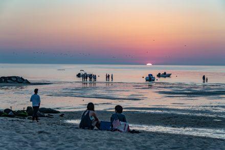 Kids relaxing on Breakwater Beach