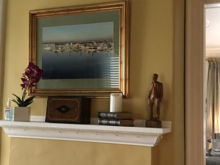 Tea room mantle with a picture of PTown harbor above