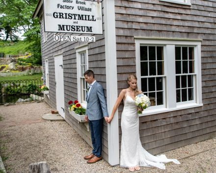 Bride and Groom standing by the Brewster Grist Mill